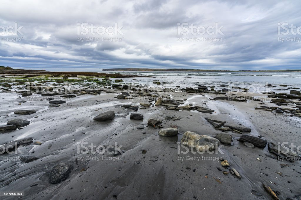 Dramtic sky over Dunnet Bay with Dunnet Head on the foreground, Scotland north coast, Britain stock photo
