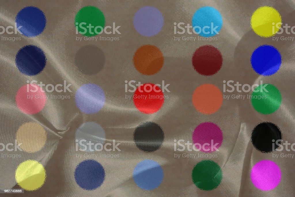 Draped satin decorate with colorful stickers in motion - Foto stock royalty-free di Arte moderna