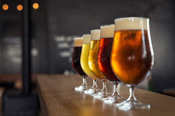 draught beer in glasses - beer alcohol stock pictures, royalty-free photos & images