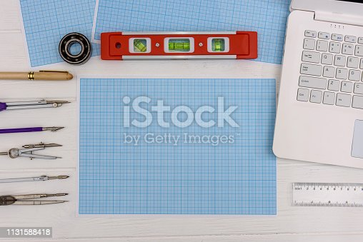 1060723604istockphoto Draughtsmanship equipment for drawing on millimeter paper with laptop 1131588418