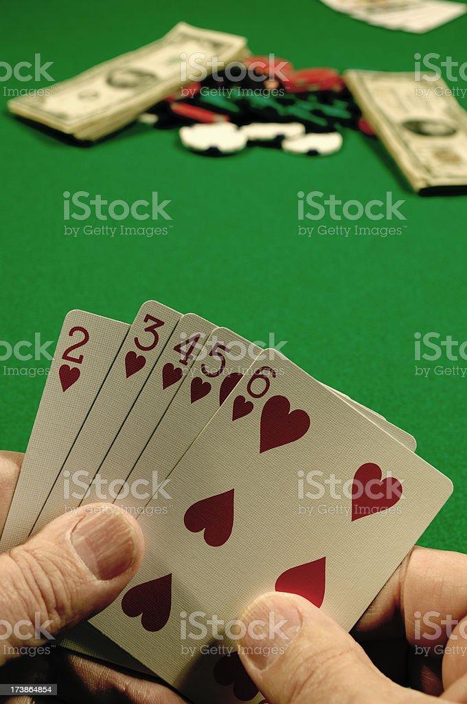 Draw Poker Holding a Straight Flush royalty-free stock photo