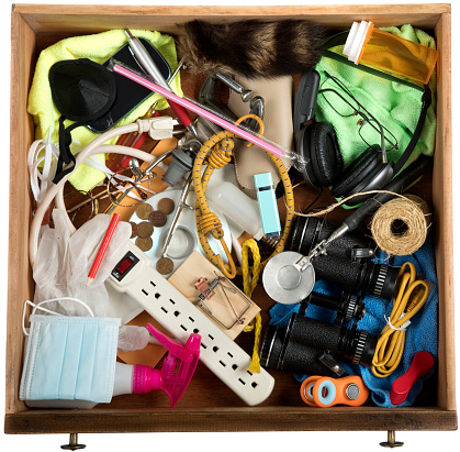 Junk Drawer with many miscellaneous objects.