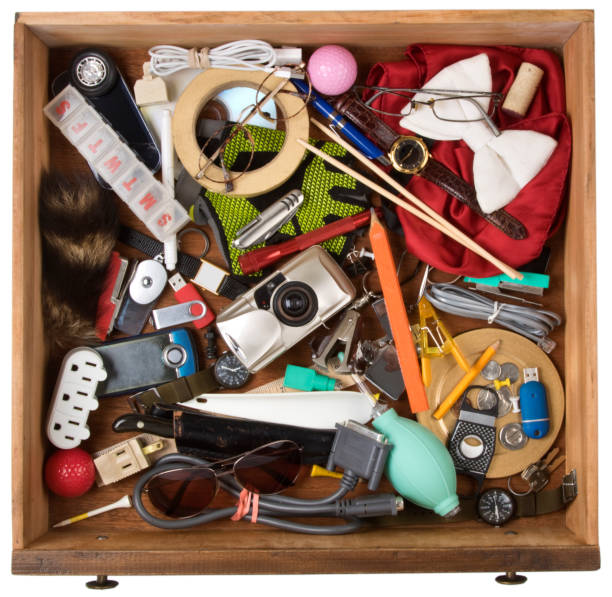 Drawer full of junk, of various household items. On a white background with clipping path stock photo