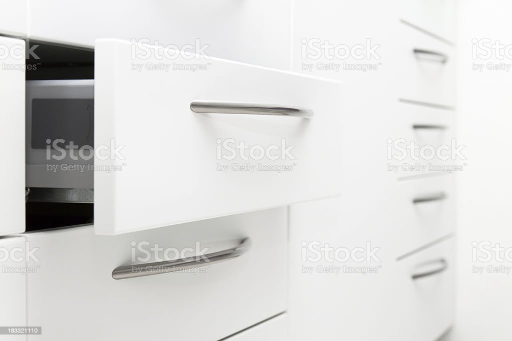Drawer of a simple modern white cabinet stock photo