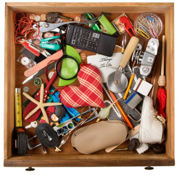 Drawer  of junk, of various household items. Isolated on a white background with clipping path stock photo