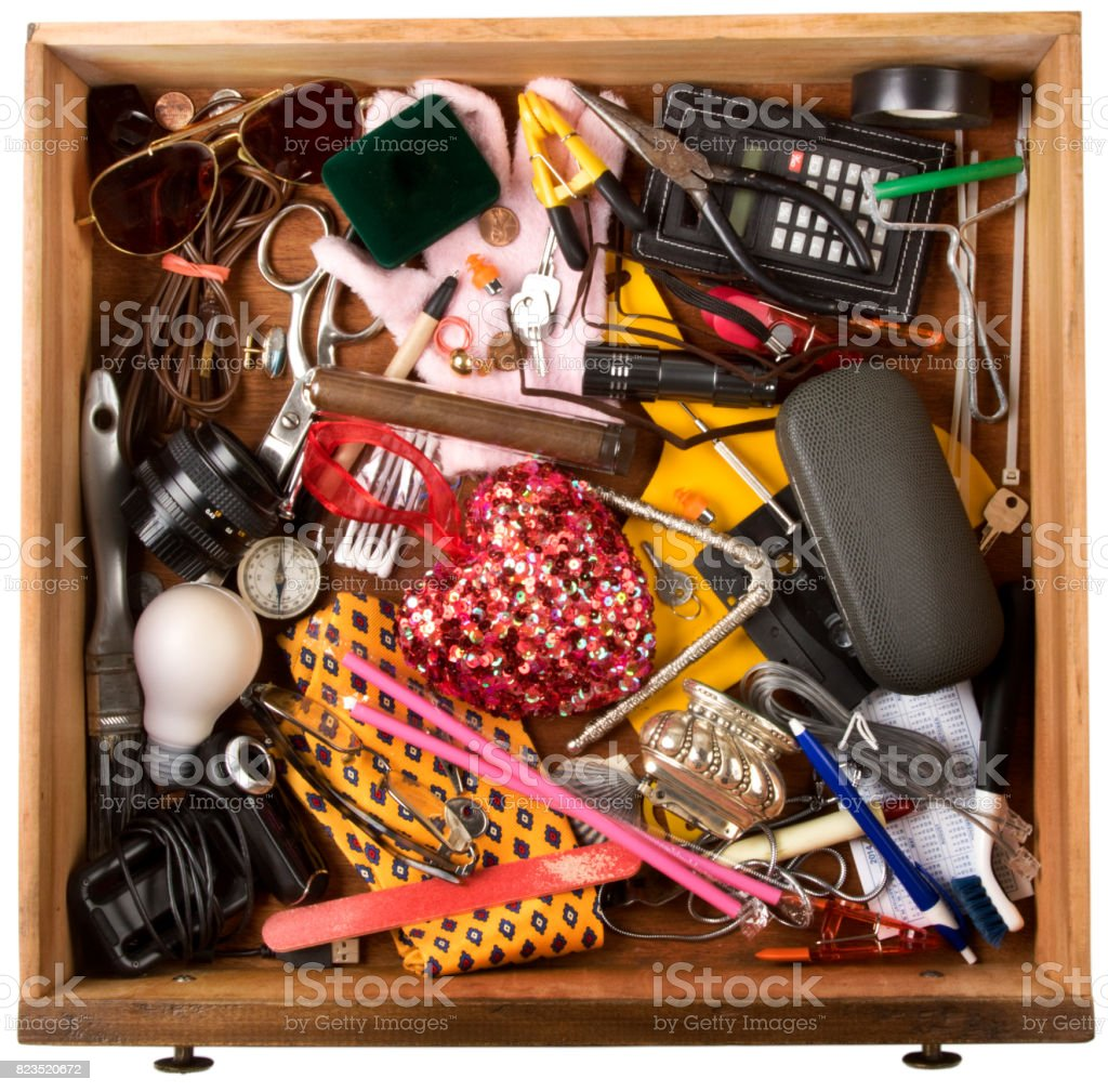 Drawer  Of Stuff, of various household items. Isolated on a white background with clipping path stock photo