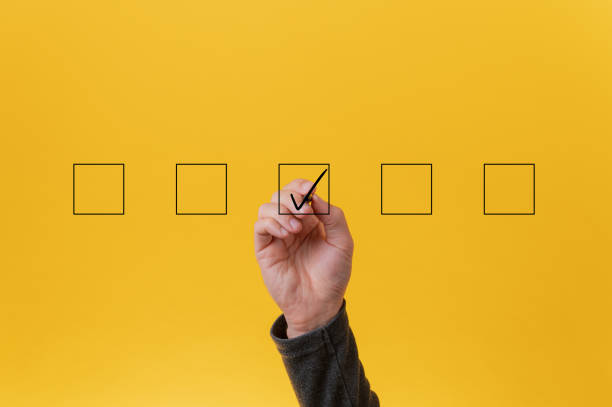 Drawing a check mark in the middle box in a row of five stock photo