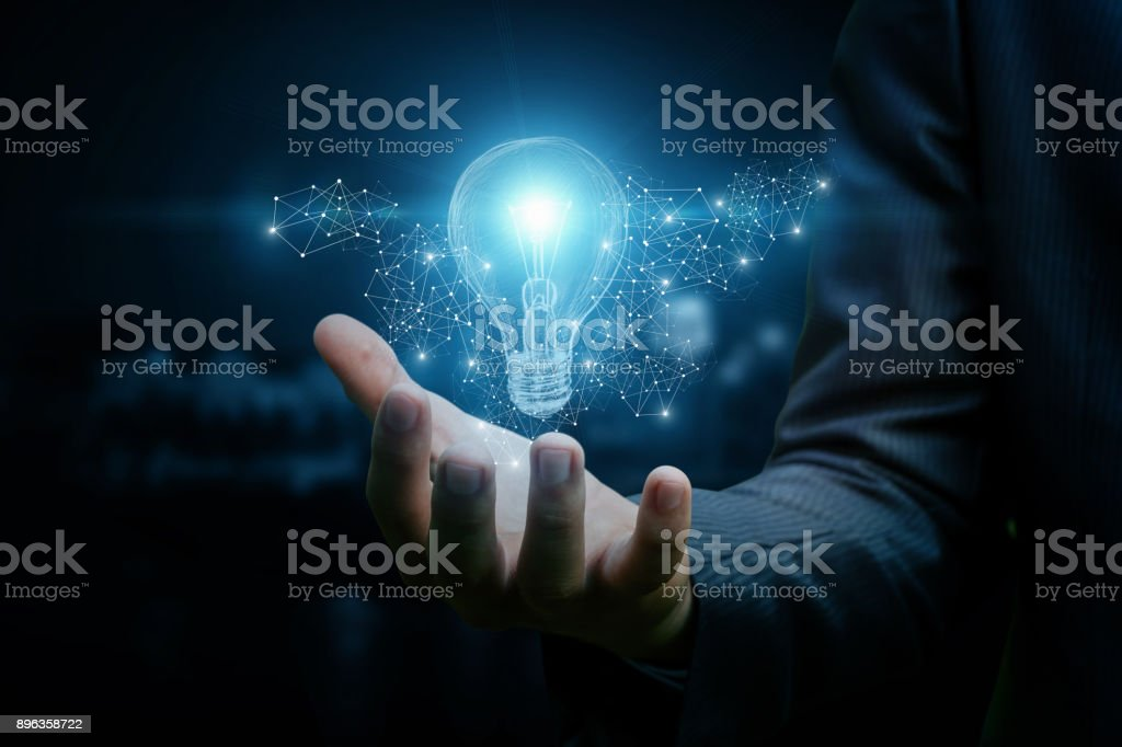 Drawing a light bulb in hand businessman. stock photo