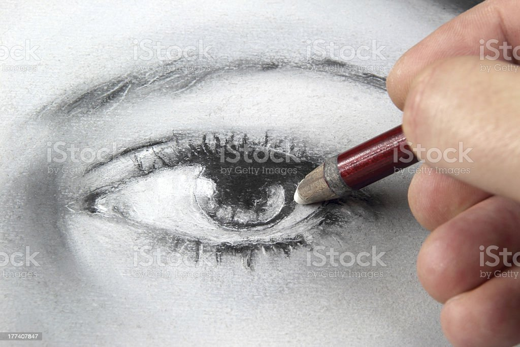 Drawing a portrait - eye close up stock photo