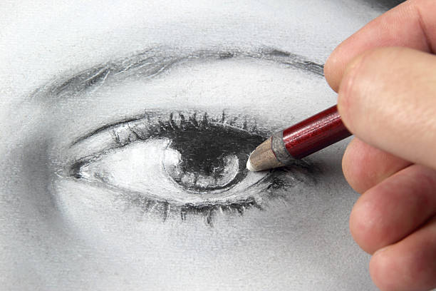 drawing a portrait - eye close up - pencil drawing stock pictures, royalty-free photos & images