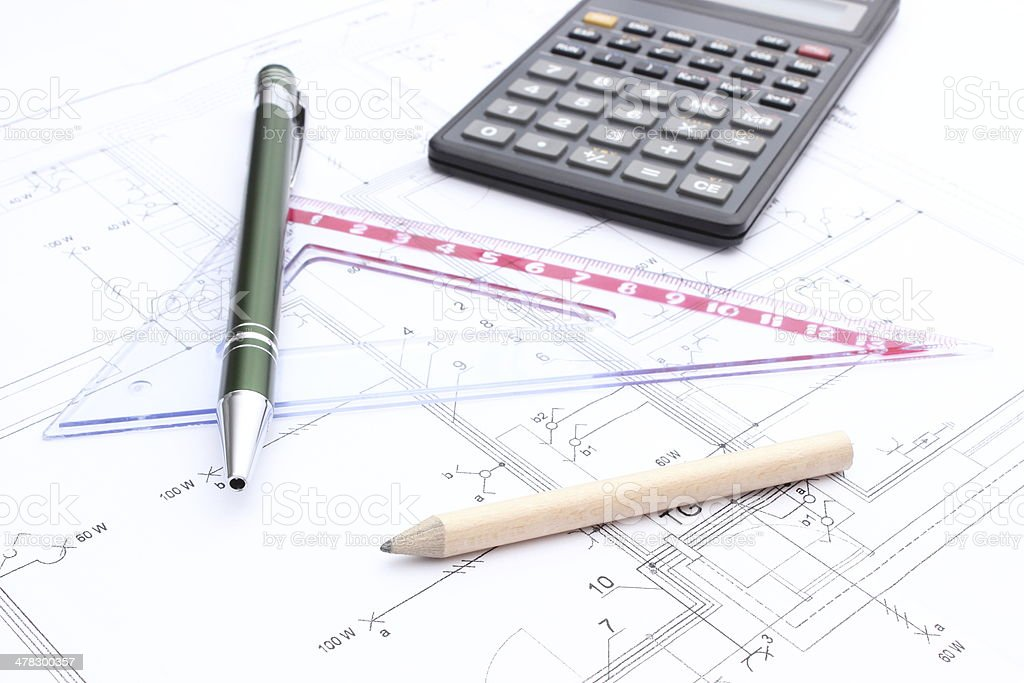 Drawing accesories and calculator on housing plan royalty-free stock photo