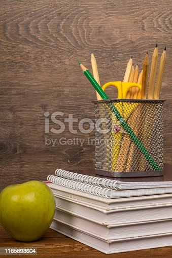 istock drawing and green pencils in basket on text and exercise books, education or back to school concept 1165893604