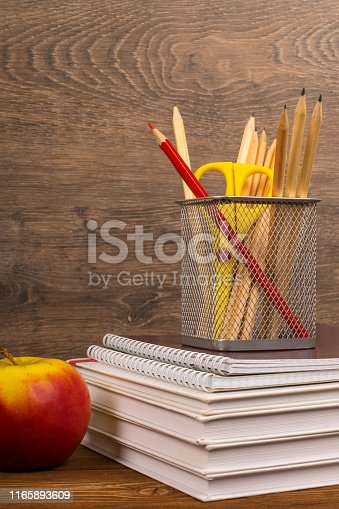 istock drawing and red pencils in basket on text and exercise books, education or back to school concept 1165893609