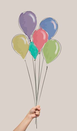 istock Drawing Bunch of air balloons, group of ball in human hand 1129348380
