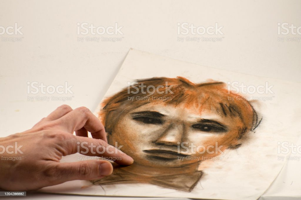 https www istockphoto com photo drawing by sanguine pencil and charcoal portrait of a man gm1204286882 346459888