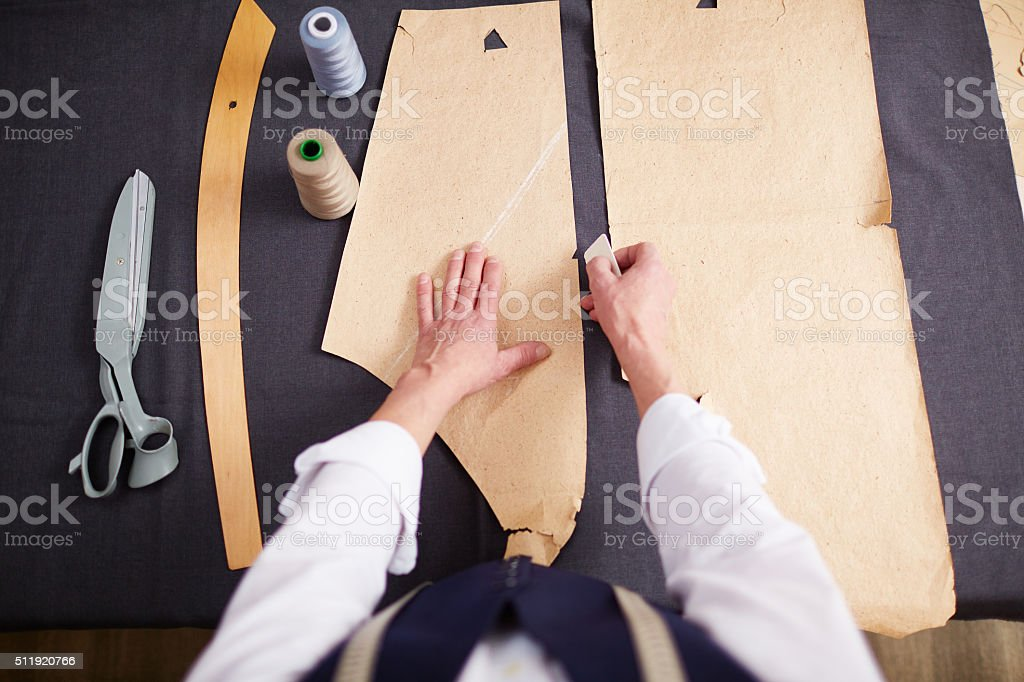 Drawing contours of paper patterns stock photo