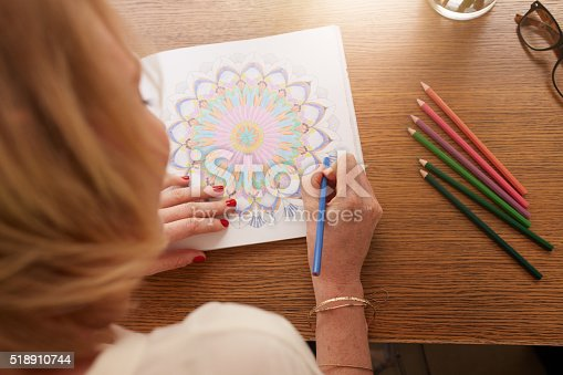 istock Drawing in adult coloring book 518910744