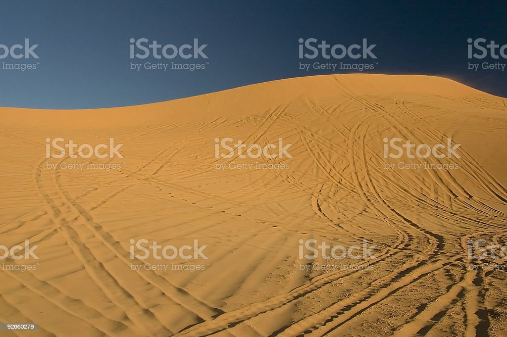 Drawing lines on the sand stock photo