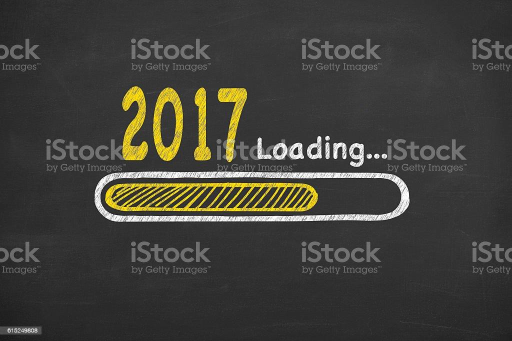 Drawing Loading New Year 2017 on Blackboard stock photo