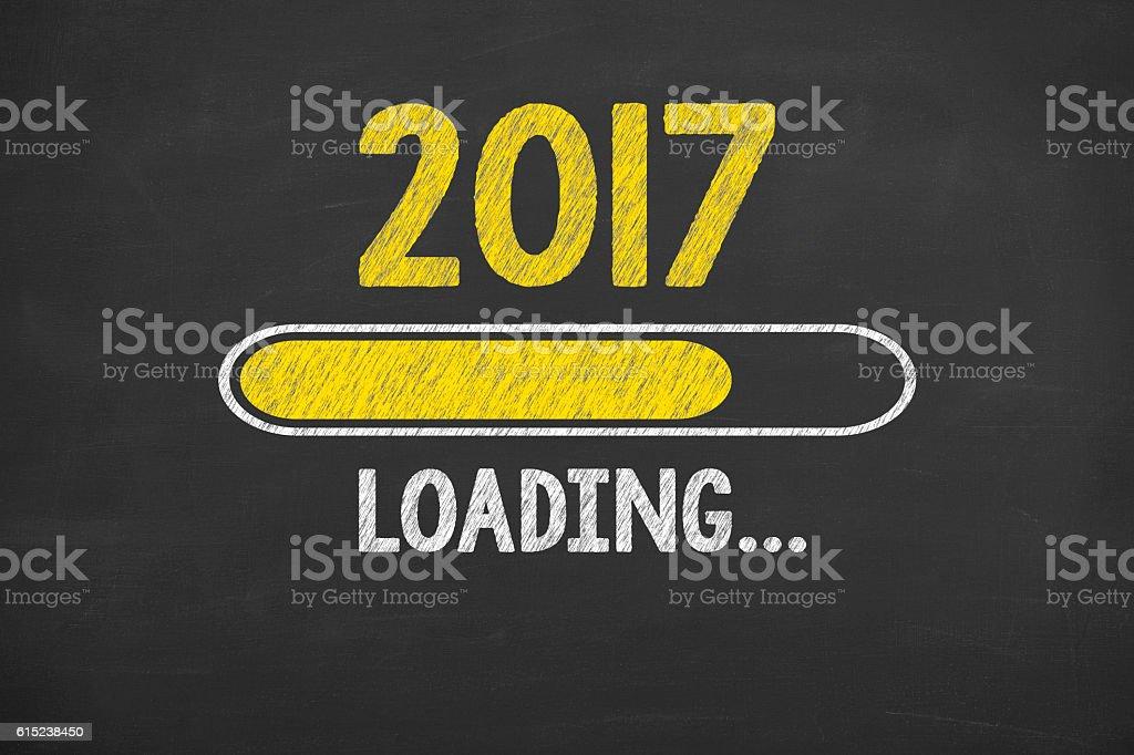 Drawing Loading New Year 2017 on Chalkboard - Foto de stock de 2017 libre de derechos