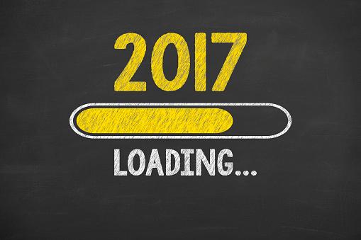 Drawing Loading New Year 2017 On Chalkboard Foto de stock y más banco de imágenes de 2017