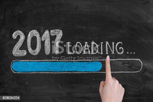 istock Drawing Loading New Year 2017 on Chalkboard 628034224