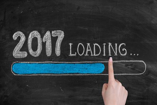 istock Drawing Loading New Year 2017 on Chalkboard 628034224