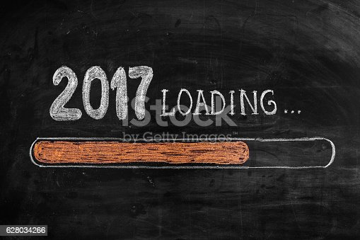 istock Drawing Loading New Year 2017 on Chalkboard 628034266