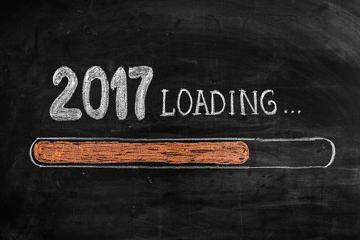 istock Drawing Loading New Year 2017 on Chalkboard 628034266