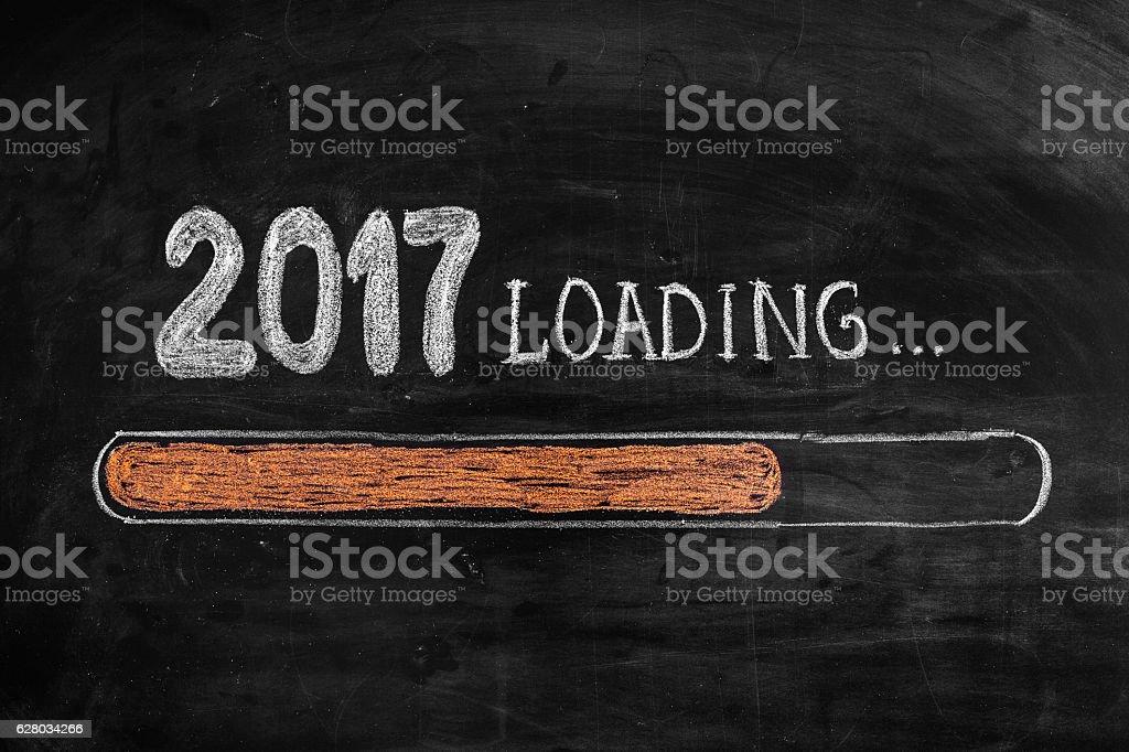 Drawing Loading New Year 2017 on Chalkboard stock photo