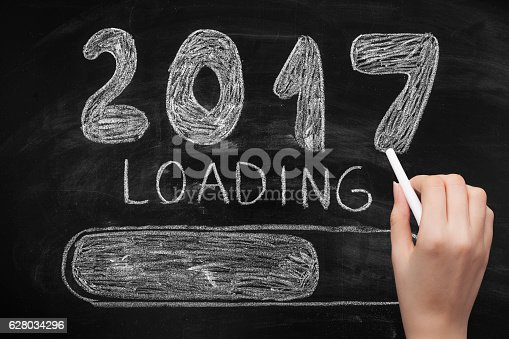 istock Drawing Loading New Year 2017 on Chalkboard 628034296