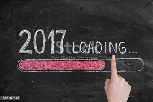 istock Drawing Loading New Year 2017 on Chalkboard 636162418