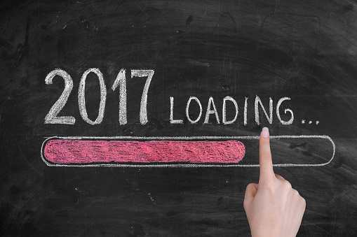 istock Drawing Loading New Year 2017 on Chalkboard 636162418