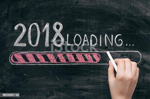 istock Drawing Loading New Year 2018 on Chalkboard 865989746