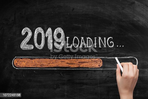 istock Drawing Loading New Year 2019 on Chalkboard 1072245158