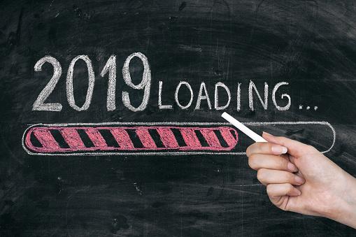 istock Drawing Loading New Year 2019 on Chalkboard 1073989670