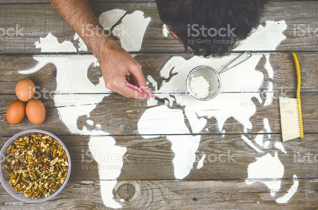 Drawing maps of the world with flour stock photo