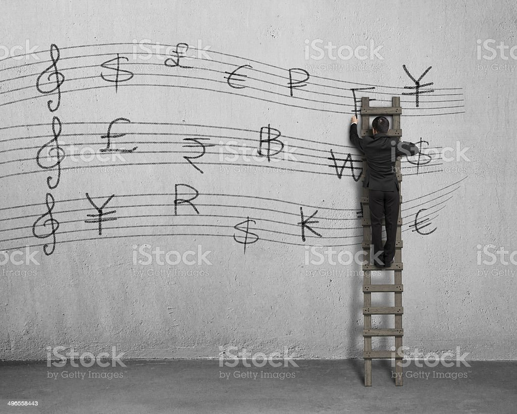 Drawing money symbol stave on wall royalty-free stock photo