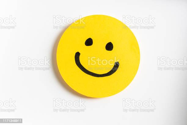 Drawing Of A Happy Smiling Emoticon On A Yellow Paper And White Background Stock Photo - Download Image Now