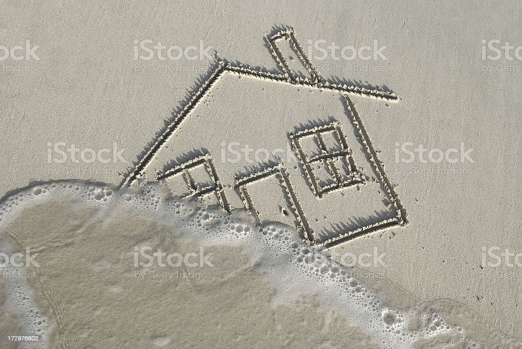 Drawing of a Home in Sand Swept Away by Wave stock photo