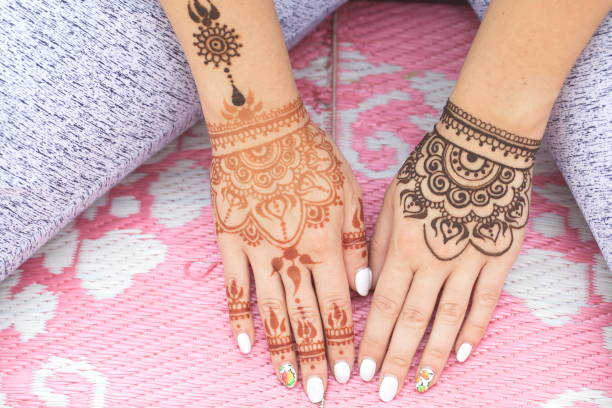 drawing of a mehendi on the hand stock photo