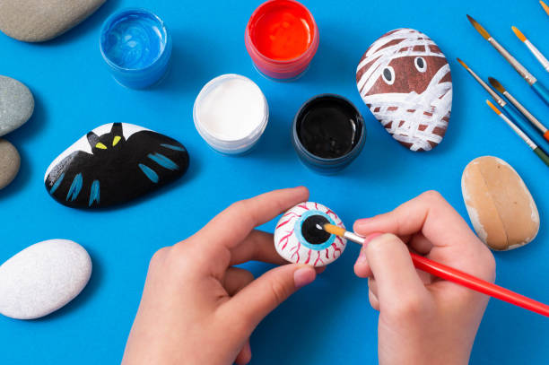 Drawing on stones Halloween characters stock photo