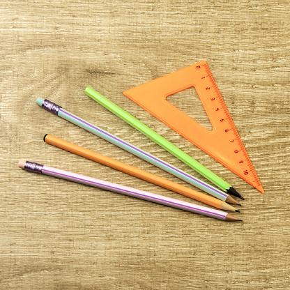 istock drawing ruler, pencil on a wooden background Top view, flat lay 1213673583