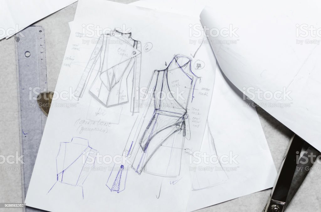 drawing sketches on paper, fashion designer stock photo