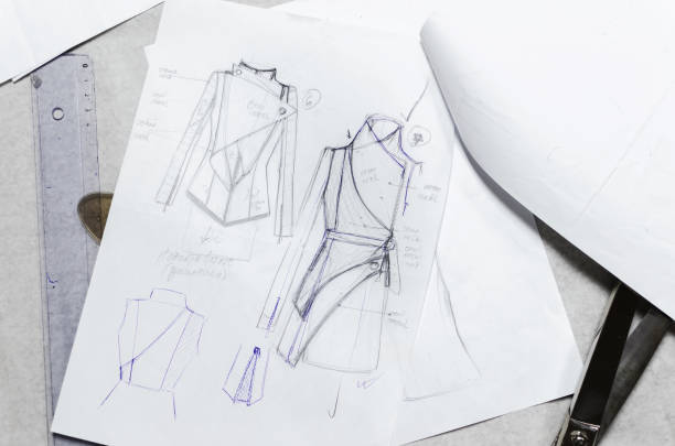 drawing sketches on paper, fashion designer - sketch stock photos and pictures
