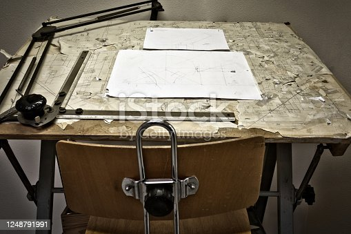 476601452 istock photo drawing table with blueprints, architect table, vintage, sketches close up 1248791991