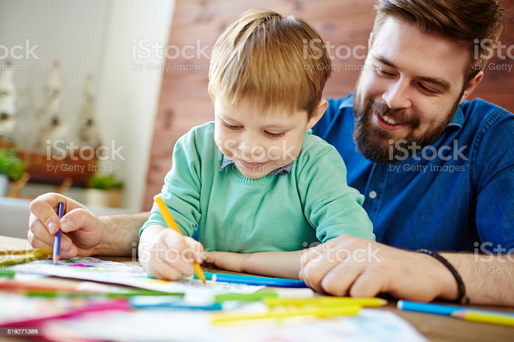 Drawing with father stock photo