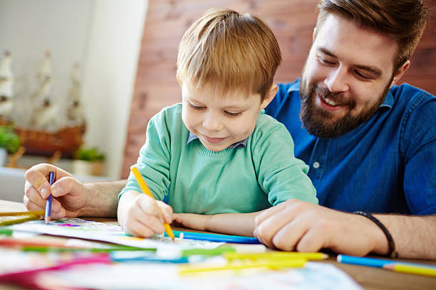 drawing with father - colouring book stock photos and pictures
