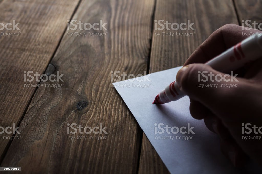 drawinga with a felt-tippers on a grey wooden bacground stock photo
