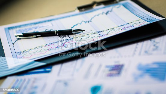 istock Drawings and charts of successful business, workplace of the businessman in office 879598600